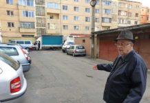 Eustaţiu Plop, nemulţumit de maşinile transport marfă care blochează parcarea